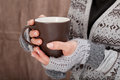 Woman with hot chocolate mug inside closeup Royalty Free Stock Images