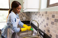 Woman house chores beautiful african american doing Stock Images