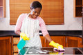 Woman house chores pretty young african doing Stock Image