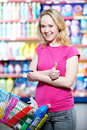 Woman at household chemistry shopping choosing produces in mall Stock Photos