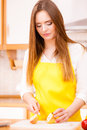 Woman housewife in kitchen cutting apple fruits Royalty Free Stock Photo