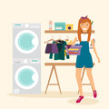 Woman housewife washes clothes. Laundry room with facilities for