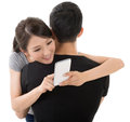 Woman hug her boyfriend asian women and use the cellphone Stock Images