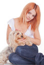 Woman hug a yorkshire young terrier puppy Royalty Free Stock Photography
