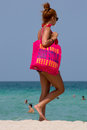 Woman with huge pink bag surf style in miami beach america august unidentified walking on the beautiful of america Stock Images