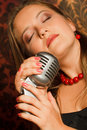 Woman hugged her hands vintage microphone Stock Image