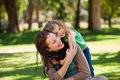 Woman hugging her daughter in the park Royalty Free Stock Photo