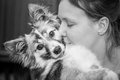 Woman hugging pet dog black and white portrait of young cute Royalty Free Stock Image