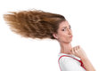 Woman with hurry blown hair steps on the gas Stock Image