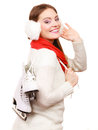 Woman with ice skates getting ready for ice skating winter sport activity smiling girl wearing warm clothing on white studio shot Stock Photos