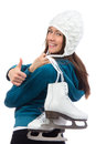 Woman with  ice skates thumb up Stock Photography