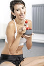 Woman ieating fruit in fitness clothes Royalty Free Stock Photography