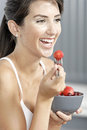 Woman ieating fruit in fitness clothes Royalty Free Stock Photo
