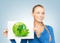 Woman with illustration of green eco globe Stock Photography