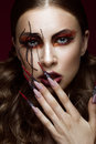 Woman in the image of spider with creative art makeup and long nails. Manicure design, beauty face. Royalty Free Stock Photo