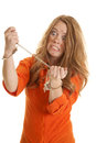 Woman inmate cuffs crazy a in an orange jumpsuit in handcuffs looks Stock Photography