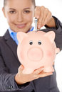 Woman inserting banknote into a piggy bank happy wearing formal jacket while folded concept of saving money and profit Royalty Free Stock Image