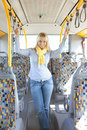 Woman inside a bus holds on tight to handles Royalty Free Stock Photos