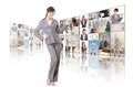 Woman introduce business women and standing in front of tv screen wall Royalty Free Stock Images