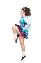 Woman in irish dance dress dancing isolated young and wig Royalty Free Stock Photos