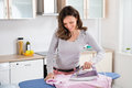Woman Ironing Cloth With Electric Iron Royalty Free Stock Photo