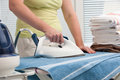 Woman ironing clothes close up of a with a steam iron Royalty Free Stock Photo