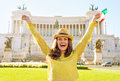 Woman with italian flag rejoicing in rome portrait of happy young on piazza venezia italy Stock Image