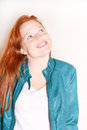Woman with a jacket attractive young redhead green Stock Image