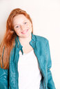 Woman with a jacket attractive young redhead green Stock Photo
