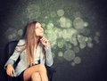 Woman in jacket, blouse sits on chair and looking Royalty Free Stock Photo