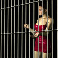 Woman In Jail Royalty Free Stock Image