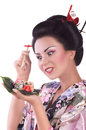 Woman in japanese kimono with chopsticks and sushi roll young isolated on white background Royalty Free Stock Image