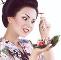 Woman in japanese kimono with chopsticks and sushi roll young isolated on white background Royalty Free Stock Images