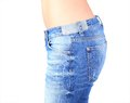 Woman jeans waist wearing weight loss stomach closeup skinny on a healthy slim fit body Royalty Free Stock Photo