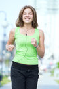 Woman jogging in city street park. Royalty Free Stock Photo