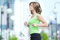 Woman jogging in city street park. Royalty Free Stock Images