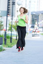Woman jogging in city street park running at beautiful summer morning sport fitness model caucasian ethnicity training outdoor Royalty Free Stock Photography