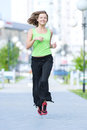 Woman jogging in city street park running at beautiful summer morning sport fitness model caucasian ethnicity training outdoor Stock Photo