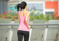 Woman jogging in city young fit asian foot bridge Royalty Free Stock Image