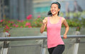 Woman jogging in city young fit asian foot bridge Royalty Free Stock Photos
