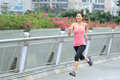 Woman jogging in city young fit asian foot bridge Stock Photography