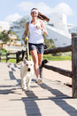 Woman jogging dog happy with her Royalty Free Stock Photo