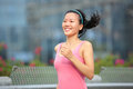 Woman jogging in downtown young fit asian city foot bridge Stock Photo