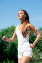 Woman jogging in the park in summer Royalty Free Stock Photos