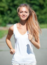 Woman jogging in the park in summer Stock Photos