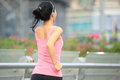Woman jogging in urban city young fit asian foot bridge Stock Photos