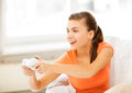 Woman with joystick playing video games picture of happy Royalty Free Stock Image