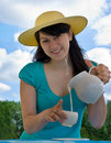 Woman with jug of the milk Royalty Free Stock Photography