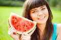 image photo : Woman with juicy watermelon in hands