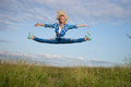 Woman jump in green grass field Stock Image